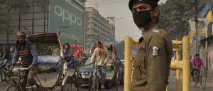 A policewoman in the Indian city of Patna directs traffic.