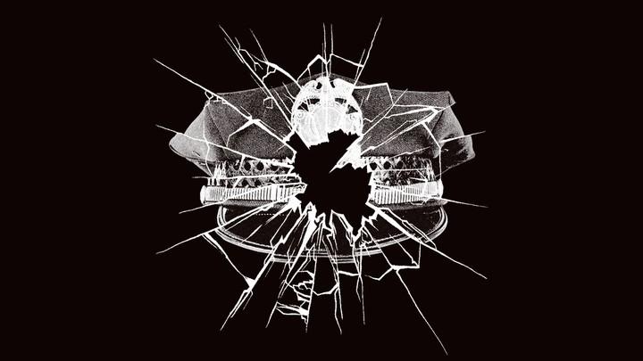 Police officer hat and broken window