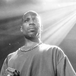 Earl Simmons, a.k.a. DMX, standing in a spotlight