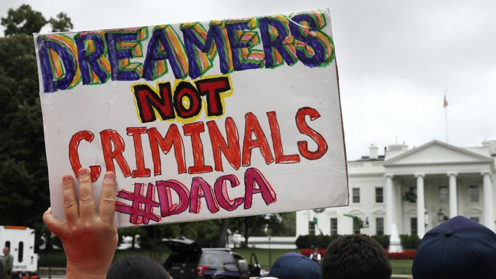 A woman holds up a sign in support of the Obama-administration program known as Deferred Action for Childhood Arrivals, or DACA.