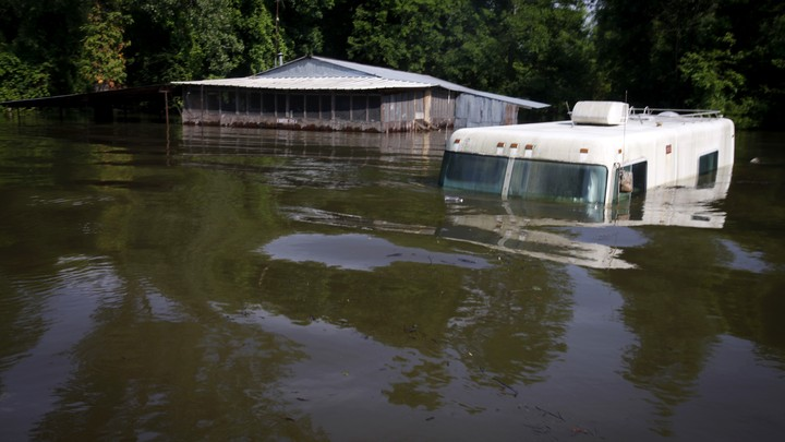 A house and RV submerged in water in Butte Larose, Louisiana in 2011.
