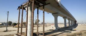 a photo of high-speed rail tracks under construction in Fresno, California.