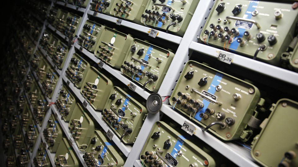 A large panel of telecommunications switchboards from the 1950s, photographed in a bunker in Bosnia and Herzegovina