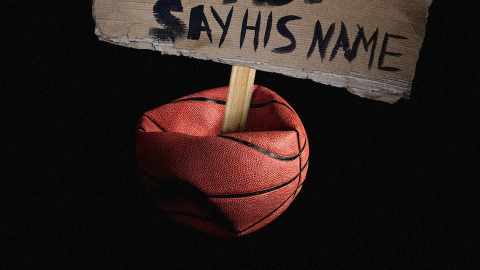 A protest sign stuck in a deflated basketball
