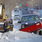 A photo of a snowplow clearing a street in Minneapolis