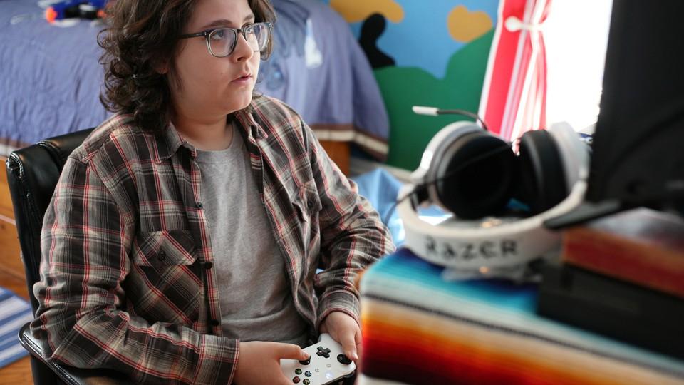 A boy holding a video-game controller