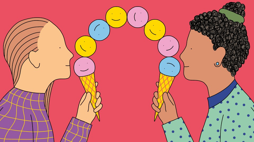 Two friends hold ice cream cones holding piles of smiley faces that connect at the middle.