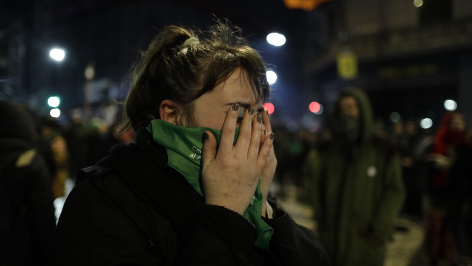 A woman reacts to the decision by Argentina's lawmakers to vote against a bill that would have loosened the country's restrictive abortion laws in Buenos Aires on August 9, 2018.