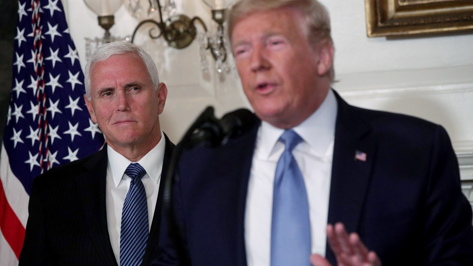 President Donald Trump delivers remarks in the White House Diplomatic Reception Room with Vice President Mike Pence standing behind him.