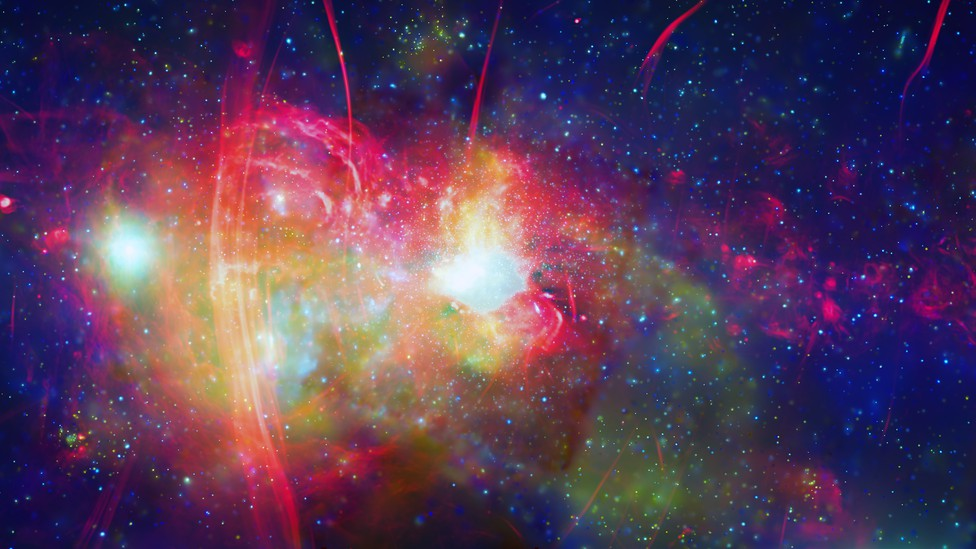 A composite rendering of the center of the Milky Way, with its supermassive black hole shrouded in clouds of gas