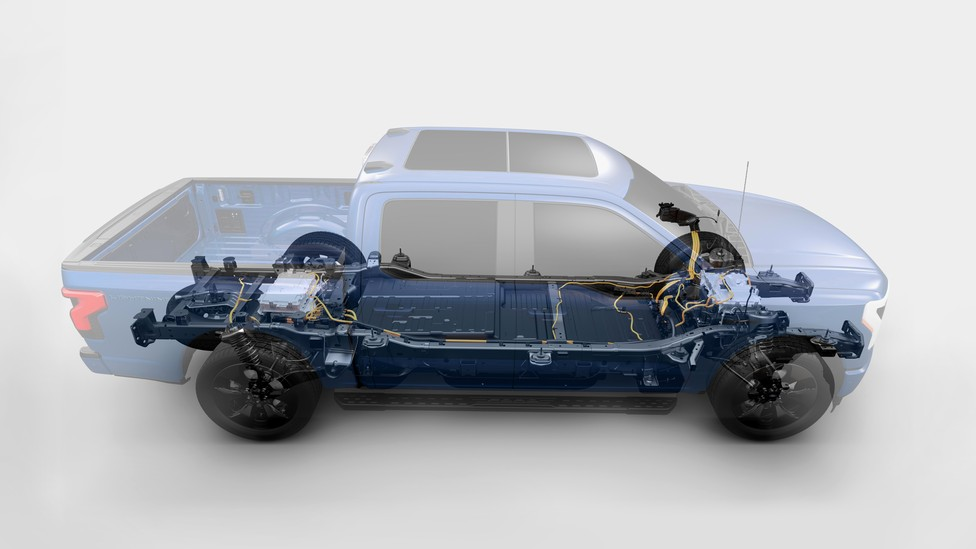 A double-exposure image of the motor and exterior of a Ford F-150