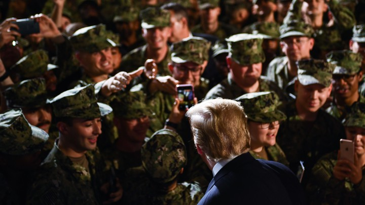 Donald Trump greets a group of marines.