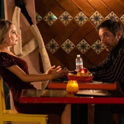 A man and his sex doll sit at a booth in HBO's 'Made for Love'