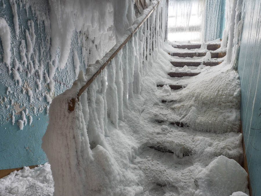 An interior stairwell is coated in ice.