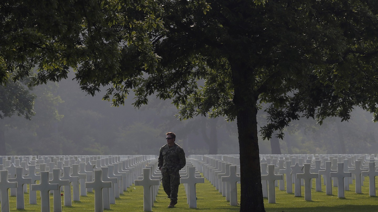An American soldier walks in the Normandy American Cemetery on June 5, 2016.