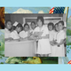 A group of university students, each dressed in white, stand at a nurses' station in Manila.
