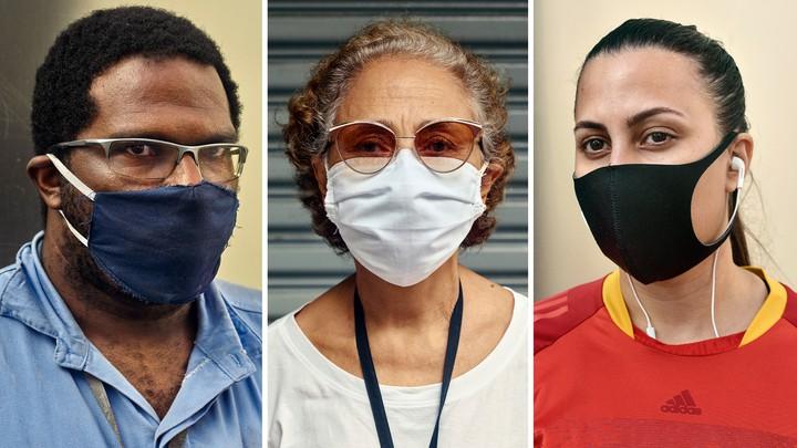 Three people wearing cloth masks