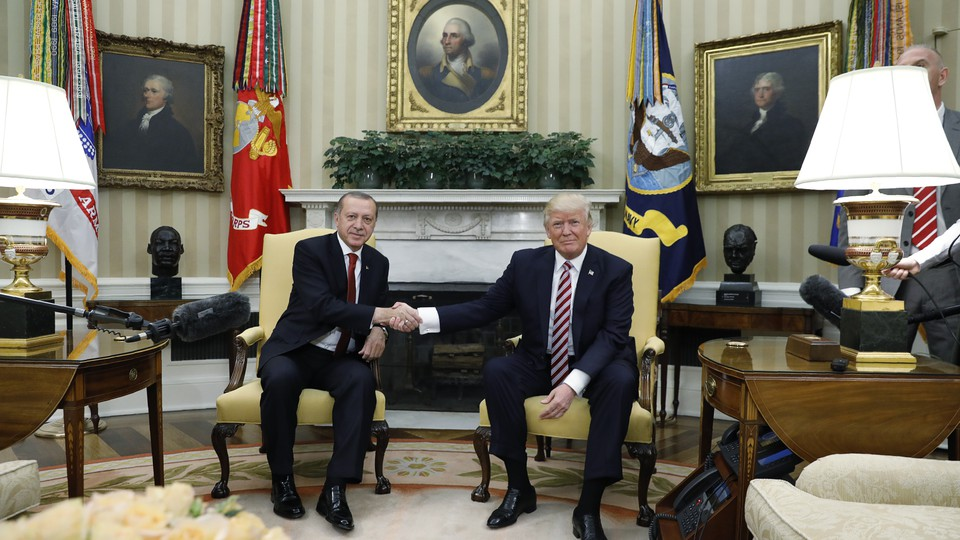 Turkey's President Recep Tayyip Erdoganshakes hands with President Trump in the Oval Office on May 16, 2017.
