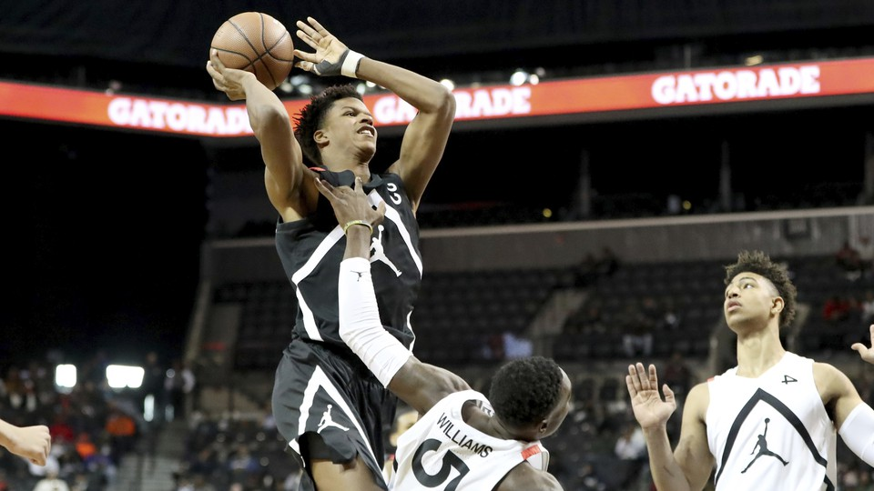 A basketball player in mid-air about to dunk