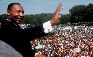 MLK waves at crowd
