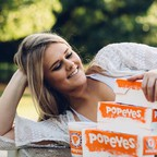 In a stunt that's gone viral, Elyse Chelsea Clark organized an fake engagement photoshoot to proclaim her love for Popeyes.