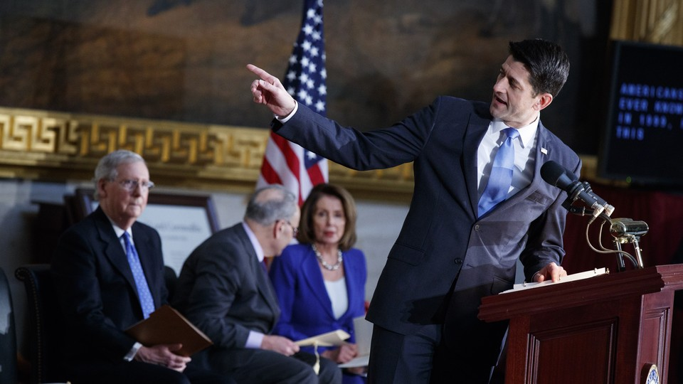 Paul Ryan speaks in front of Mitch McConnell, Chuck Schumer, and Nancy Pelosi on Capitol Hill.