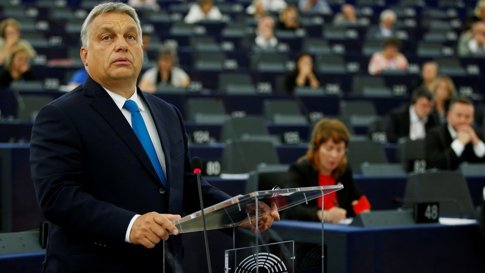 Viktor Orbán stands at a podium while addressing the European Parliament on September 11.
