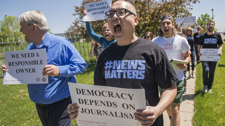 People protesting the ownership of The Denver Post