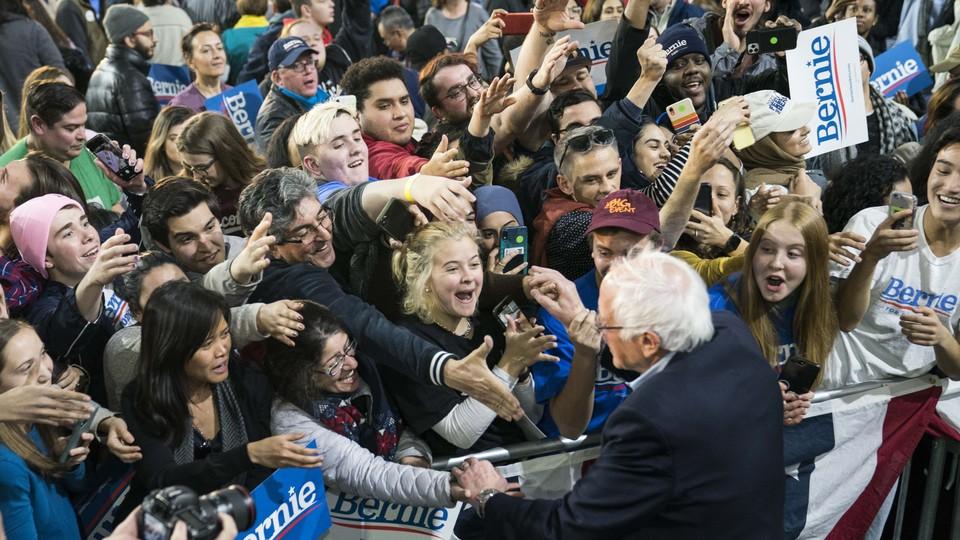 Young voters surrounding Bernie Sanders