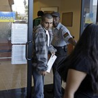 Customers leave a branch of California National Bank of Los Angeles, one day after the Federal Deposit Insurance Corporation closed CalNational and eight smaller related banks, in Los Angeles, Saturday, Oct. 31, 2009.
