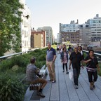 Tourists walk along the High Line in Manhattan, New York City