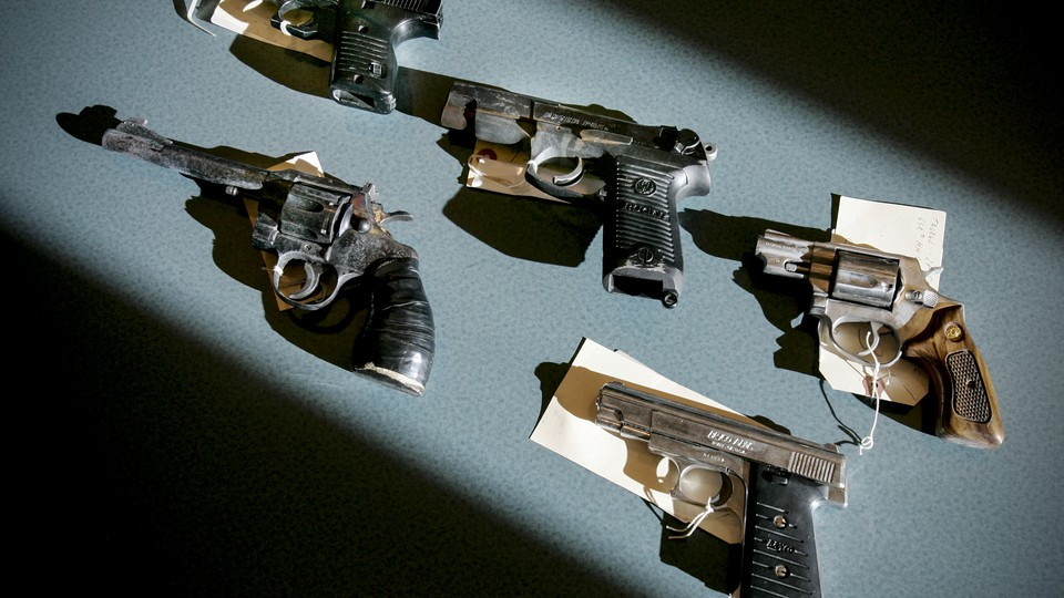 Recently seized handguns are displayed at the Boston police headquarters in Massachusetts on December 7, 2005.