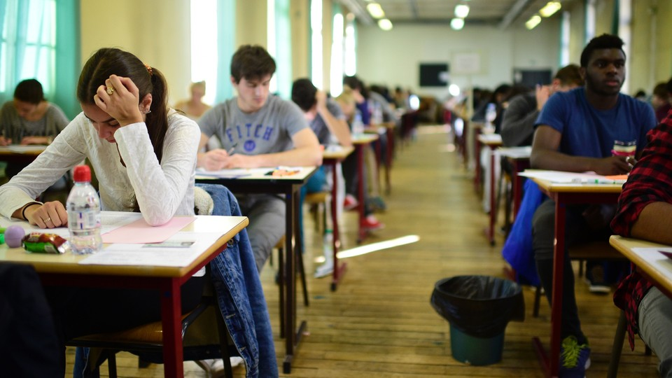 Students take an exam in class.