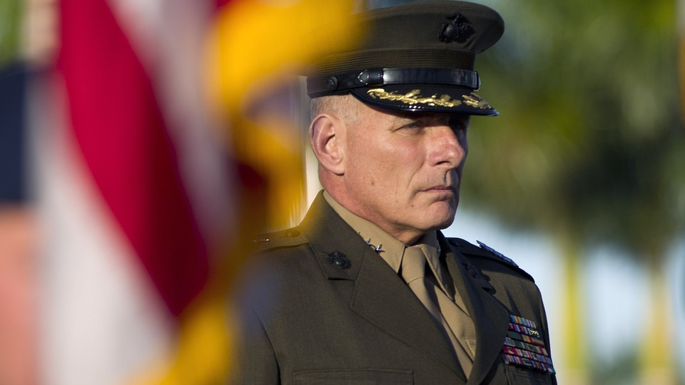John Kelly, in uniform, stands at attention during the Southern Command change-of-command ceremony in 2012, in Miami.