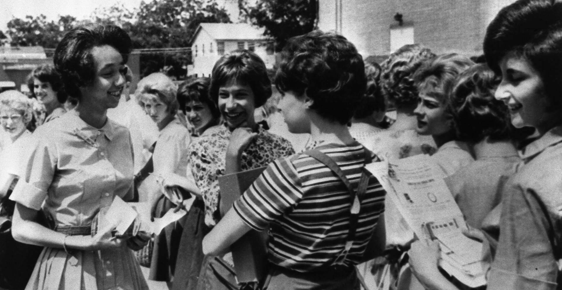 During a bomb scare at the school on September 3, 1963, 15-year-old Millicent Brown, left, chatted with fellow students outside Rivers High School.