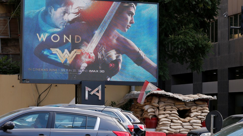 """An billboard advertising the """"Wonder Woman"""" film, which was banned in Lebanon,is pictured near an army post in Beirut onMay 31, 2017."""