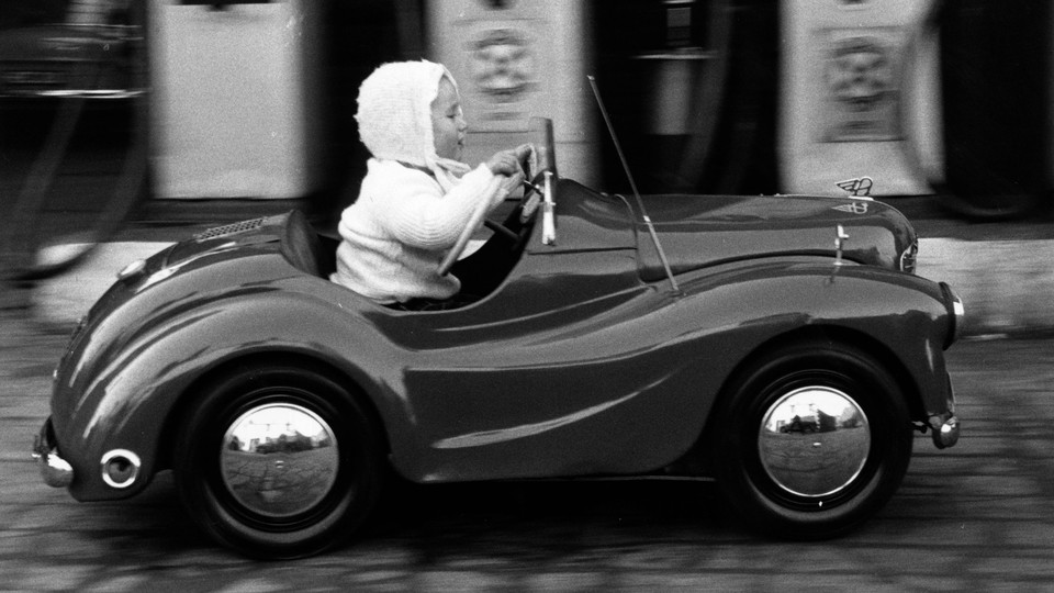 A young girl drives a car