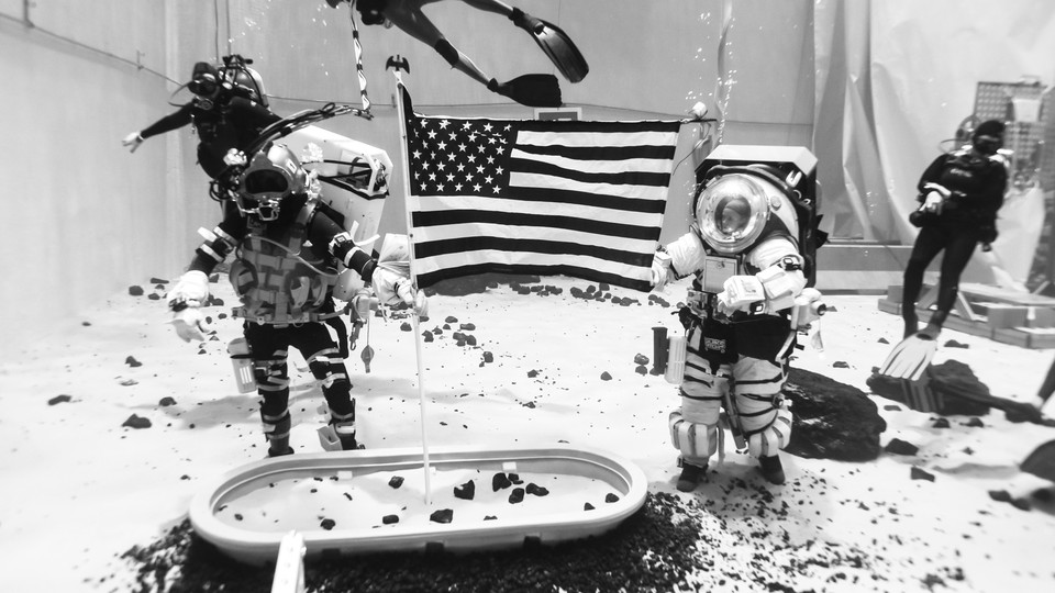 NASA astronauts practice for a future moon landing inside a training pool at Johnson Space Center