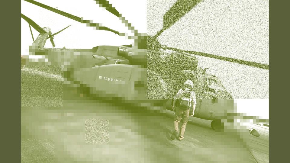 A man walks toward a helicopter