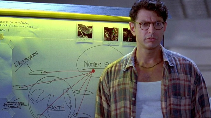 """Scene from Independence Day where Jeff Goldblum realizes he can """"give the aliens a cold"""". An egregious example of the """"plot solution in a random sentence tropes."""""""