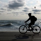 A cyclist rides along a lake shore trail in Chicago.