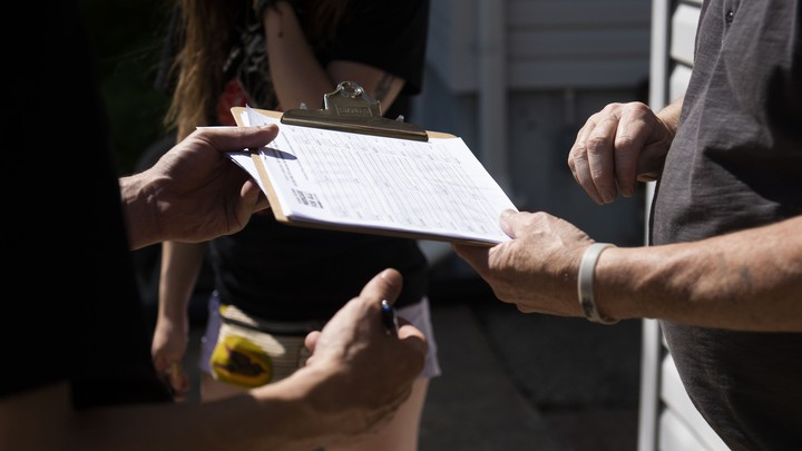 Voter canvassing with a clipboard
