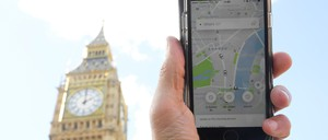 An illustration showing Uber on an iPhone near Big Ben.