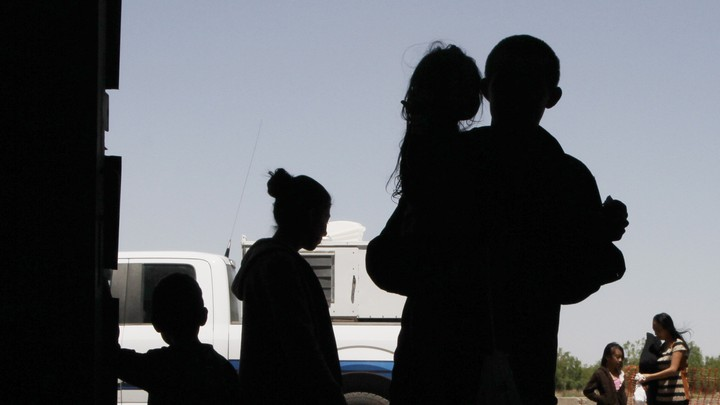A silhouette of an immigrant family