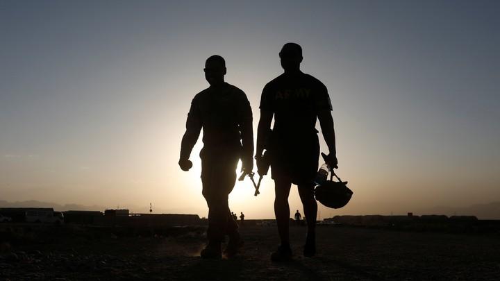 U.S. troops walk at their base in Logar province, Afghanistan, on August 4, 2018.