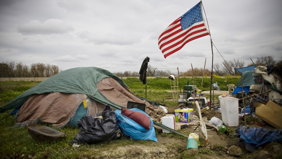 A tent city with an American flag raised