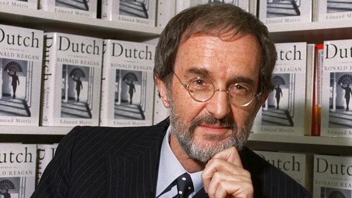"Edmund Morris in front of a shelf of ""Dutch"" copies"
