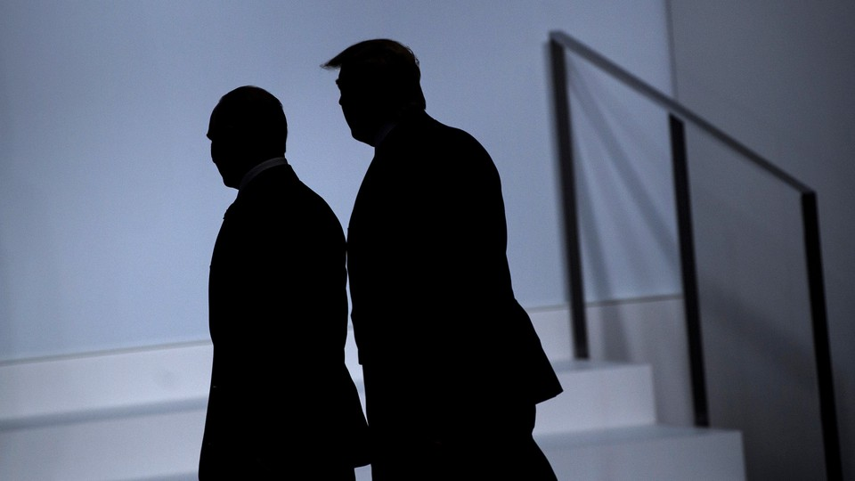 Silhouettes of Donald Trump and Vladimir Putin