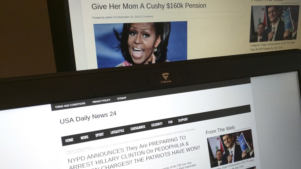 Fake news articles appear on laptop screens