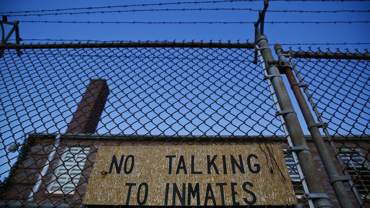 "A jail with the sign ""No Talking to Inmates"""